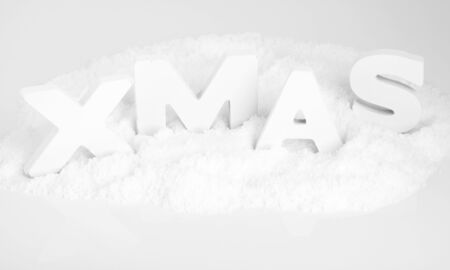 White wooden letters in snow form the word XMAS Stock Photo