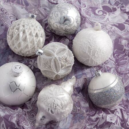 White and silver christmas balls on wrapping paper