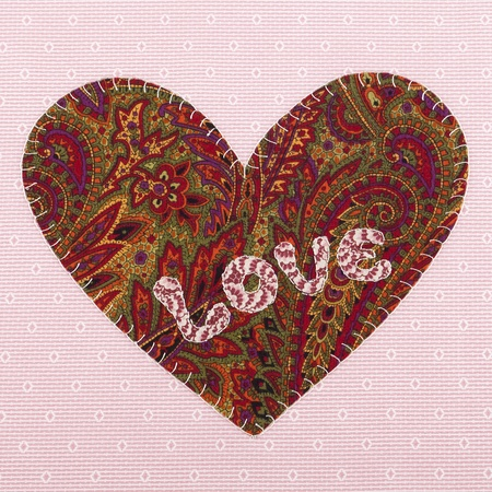 Handmade fabric heart with the word love, Valentines Day Stock Photo