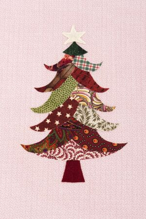 Handmade Christmas tree with different fabrics and a star Stock Photo
