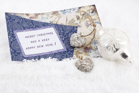 Greeting card with text for Christmas and New Year in the snow