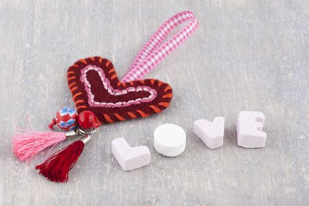 Handmade heart and the word love written with candy letters