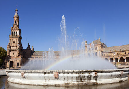 Fountain with rainbow at Plaza de Espana  Spanish Square , Seville, Spain