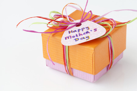 Colorful present with a card for Mothers Day on a white background