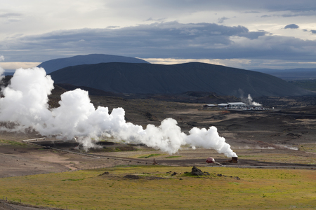 Landscape in Iceland with a large plume of smoke, Krafla geothermal power station Stock Photo