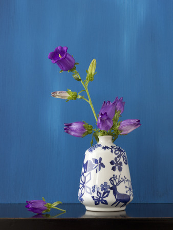 Beautiful still life of purple flowers in little vase