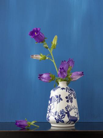 Beautiful still life of purple flowers in little vase
