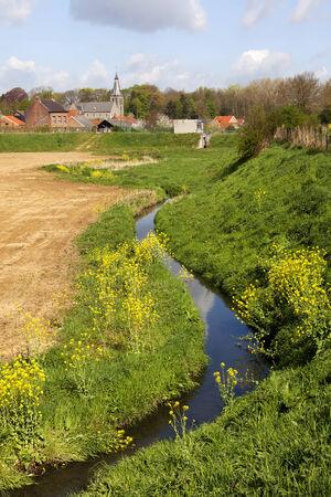 Beautiful landscape in Belgium with a little stream, Sint-Truiden, Bevingen