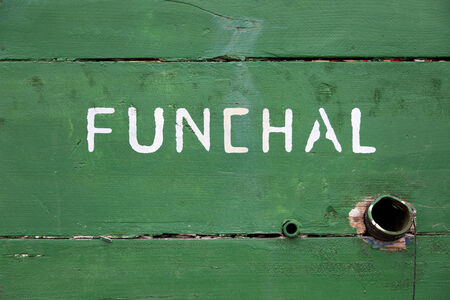 Detail of a green wooden boat with the text Funchal written on it Stock Photo