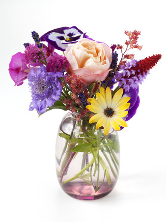 Little bouquet of garden flowers in a vase