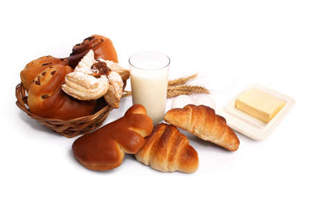 Delicious pastries, milk, eggs and butter for breakfast Stock Photo
