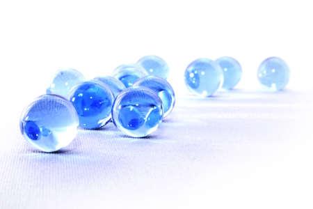 Sparkling blue glass balls on white background 写真素材