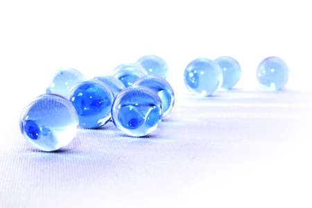 Sparkling blue glass balls on white background Banque d'images