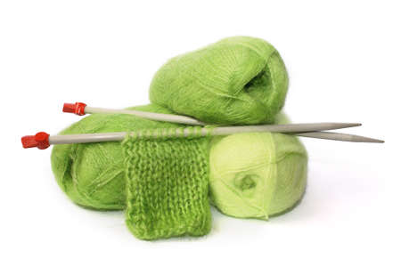 Coils Green Moher and the sample connected knitting needles
