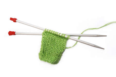 Knitting pattern, needles on a white background Stock Photo - 4570802