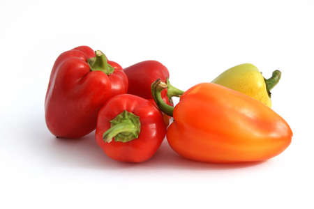 Red, orange and yellow capsicums on a white background with path Stock Photo