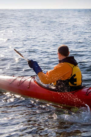 The man in the kayak floats in the sea