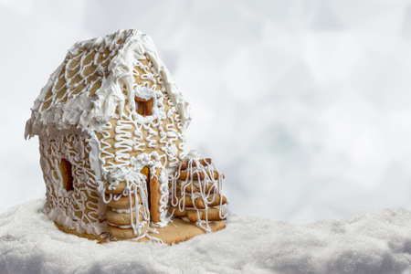 Christmas background gingerbread house in snow