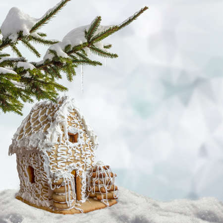Christmas square background gingerbread house in snow