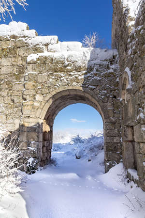 Arch of snow citadel of he ancient cave city of Mangup Kale in the snow 版權商用圖片