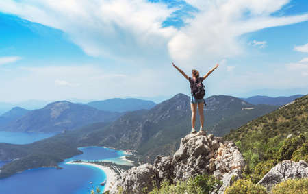Hiker girl on the mountain top, �oncept of freedom, victory, active lifestyle, Oludeniz, Turkey