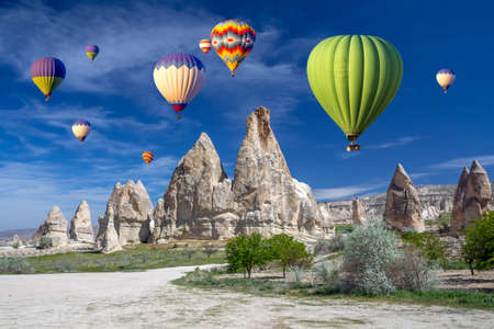 Hot air balloons over the cave town, Valley of Daggers, Cappadocia, Turkey