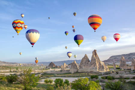Hot air balloons in the sky over the cave town, Valley of Daggers, Cappadocia, Turkey 写真素材 - 120463429