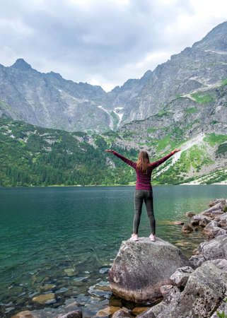 Young tourist girl on Lake Morskie Oko (Sea Eye), Zakopane, Poland, High Tatras