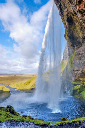 Seljalandsfoss Waterfall on a Sunny Day in Iceland Imagens - 136033448