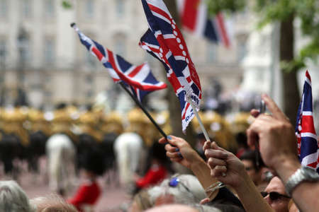 jacks: Flags waving in The Mall during Trooping The Colour 2016 with The Band of The Household Cavalry in the foreground