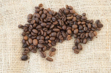 biodegradable material: beautiful macro background of coffee with jute