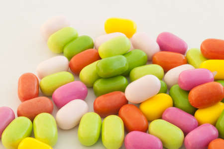 beautiful background of colored and various candy or pills photo