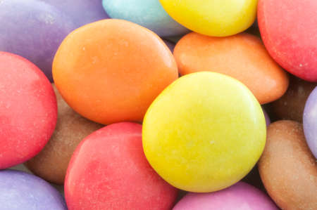beautiful background of circular colored and various candy or pills photo