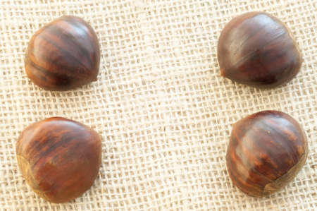 laxative: beauitful macro of chestnut in jute background Stock Photo