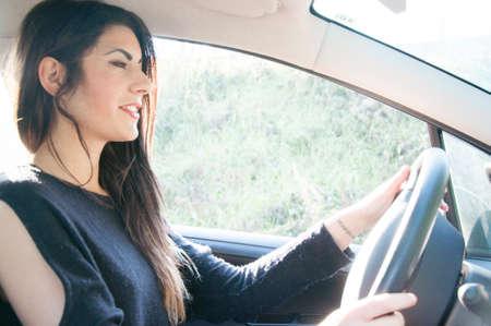 a sleepy female driver that drive his car photo