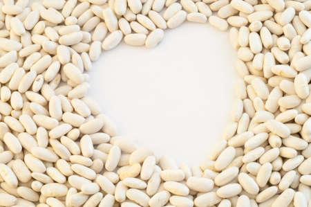 gentleness: beautiful macro background of cannellini beans in studio