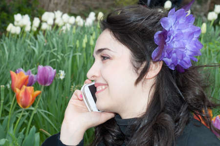 natual: beautiful smile of a girl on the phone in a beautiful day Stock Photo