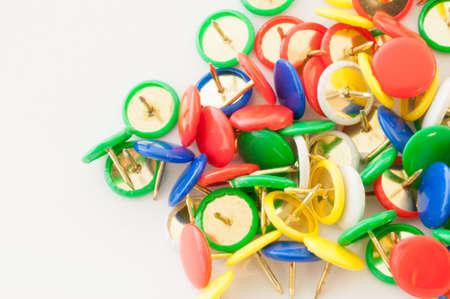 needle tip: macro background of colored thumbtacks in studio