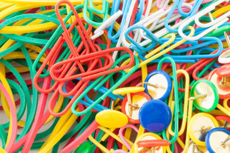 paper clips: macro background of staples elastics and paper clips