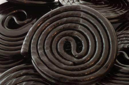 antiviral: macro background of black spiral licorice in studio
