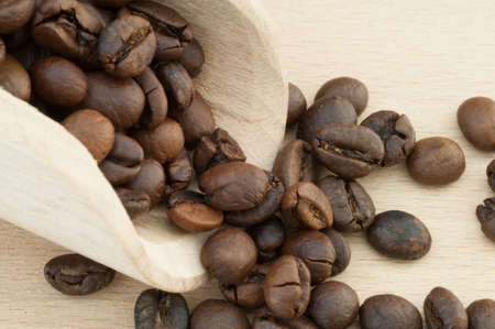 distinctive flavor: macro background of traditional spoon with coffee