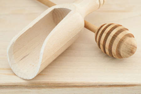 bailer: macro background of spoon and bailer on cutting board Stock Photo