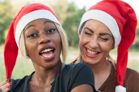 african solidarity: Christmas girls in a sunny day Stock Photo