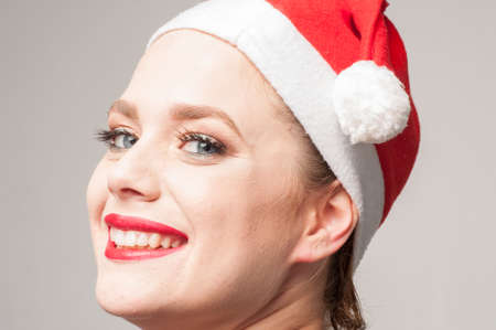 skull cap: happy and smiley caucasian girl in christmas day