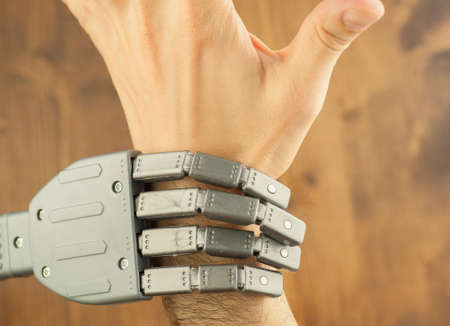 forced: robot and human hand in a battle for work