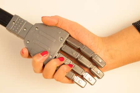 human evolution: girl and robot handshake Stock Photo