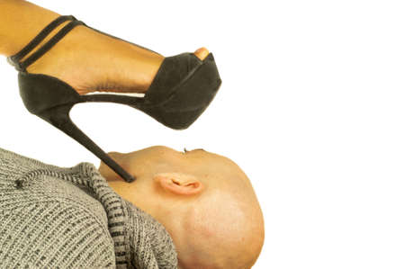 girl tramples a man with a stiletto heel