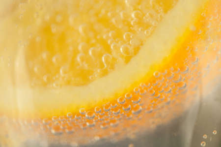 beautiful detail of orange and bubble in a glass of a sparkling water Stock Photo