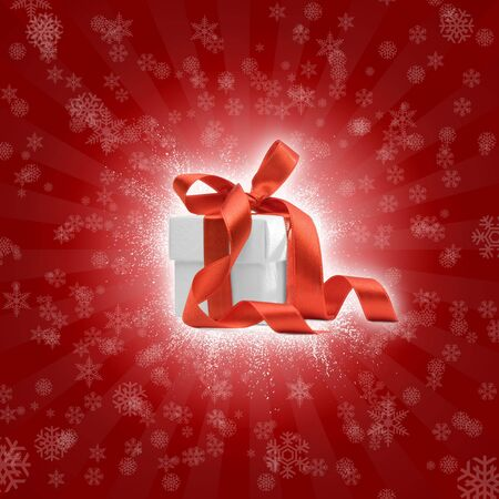 present box on red background with snowflakes. FOND MORE presents in my portfolio photo