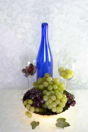 Blue wine bottle with two wine glasses